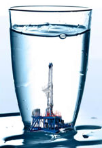 Image of drilling rig in a glass of water