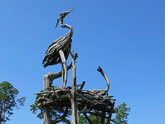 Driftwood sculpture of nesting birds