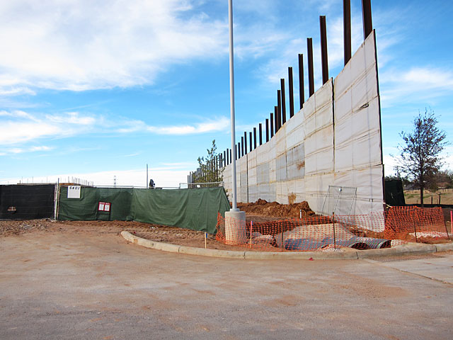 Photo of sound barrier in front of building site