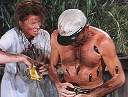 Scene from The African Queen - Humphrey Bogart covered with leeches