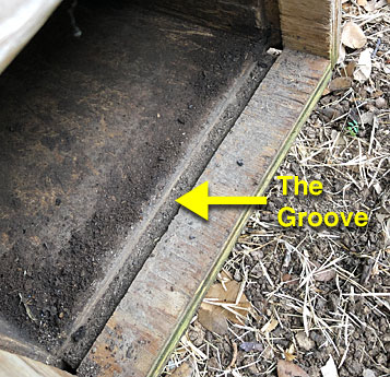 Photo showing bottom door groove in the trap