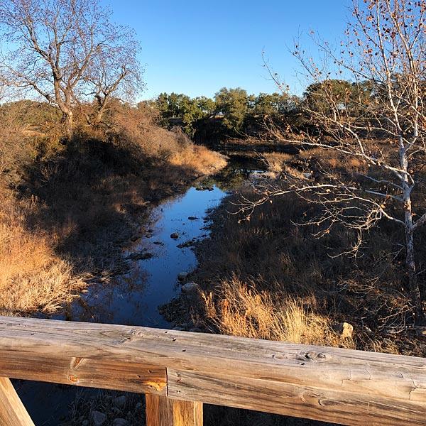 Photo - A view of Pecan Creek between from the Summit Rock bridge