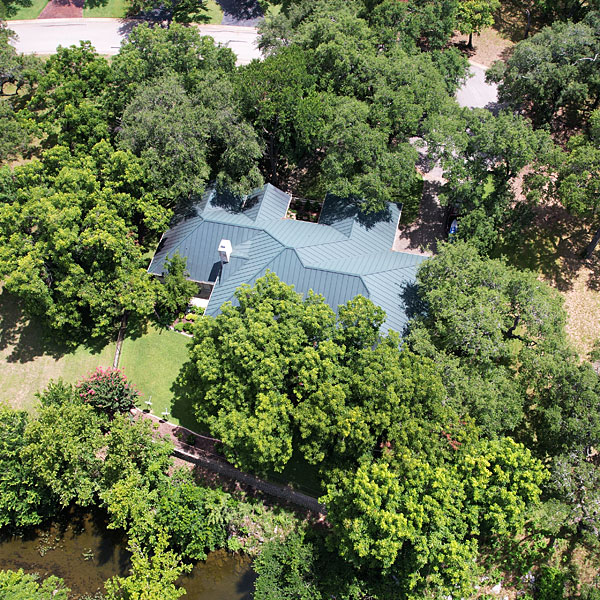 Photo - Our tree-surrounded house as seen from a drone hovering at around 75 feet