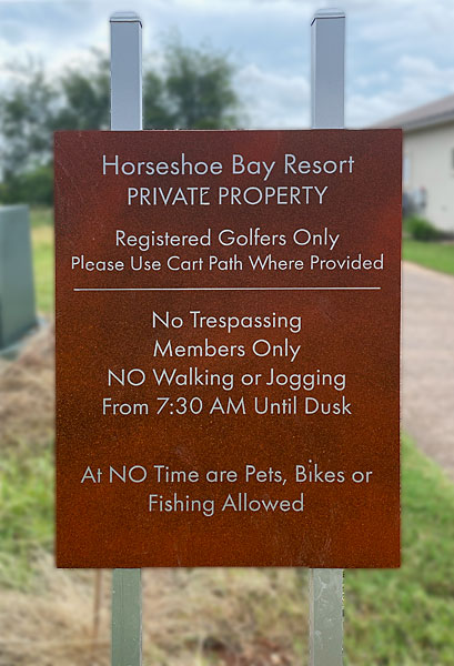 Photo - Sign on golf course prohibiting use of cart paths by anyone but golfers