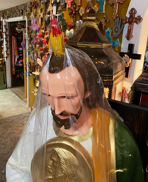 Photo - Shrink-wrapped statue of St Jude